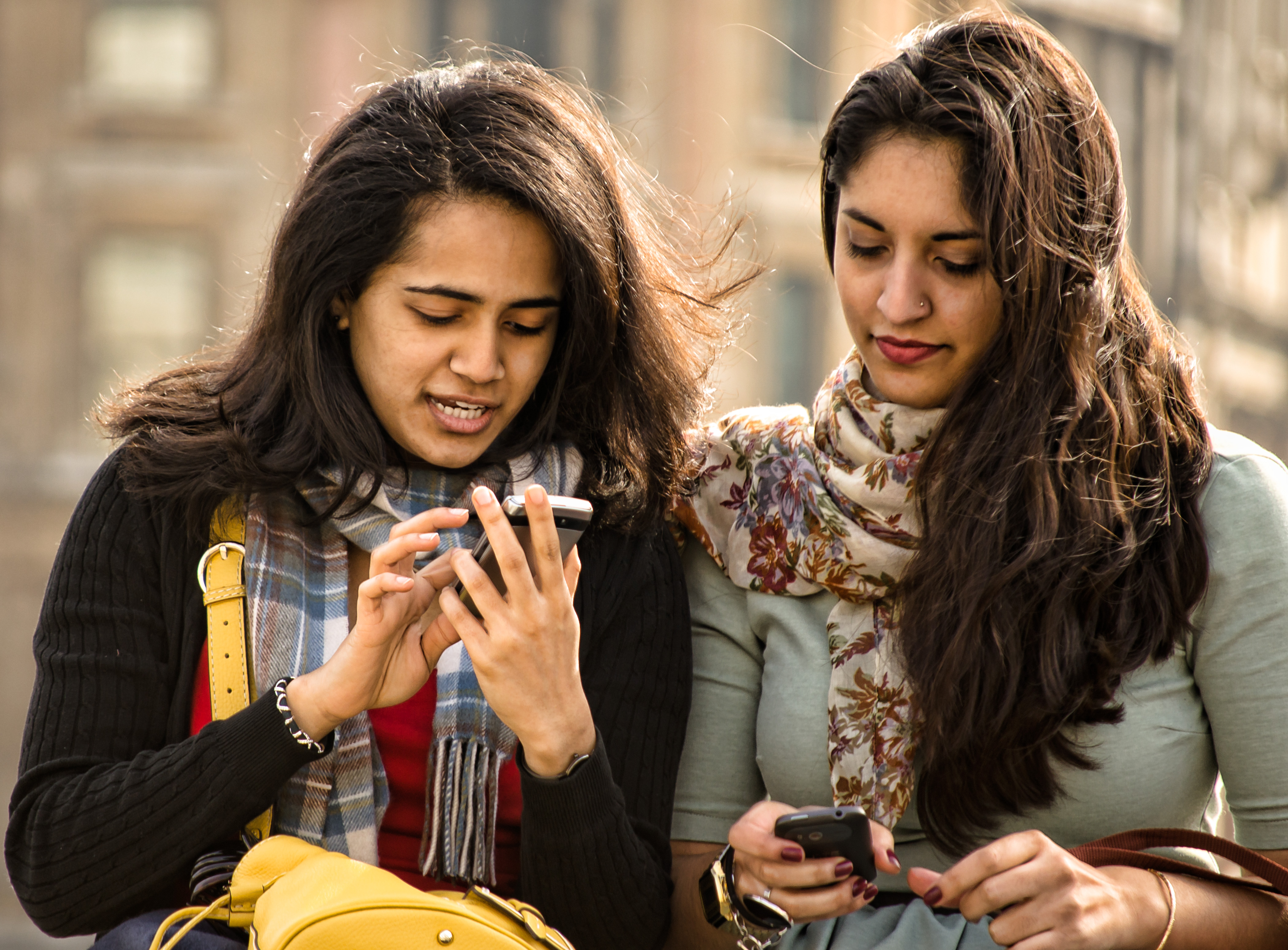 Now, instead of texting each other, you can text other people. Photo by Gary Knight.